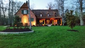 Green shuttered brick home