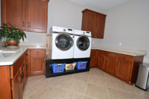 27-laundry-room-has-lots-of-storage-sink-and-closet-a